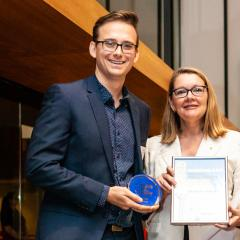 Dr Sean Coakley receiving his QLD Young Tall Poppy Award from Professor Jenny Martin AC.