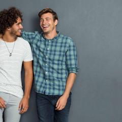 Two male friends laughing